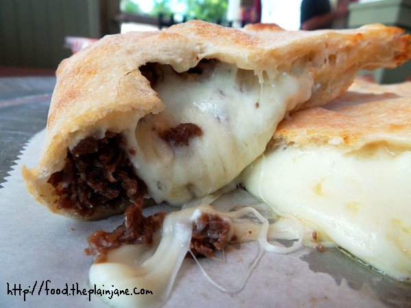 Oozy, melting, gooey cheese inside Calzone | Big Daddy's Pizza and Steak Subs - Boston, MA